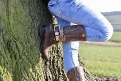 Girl in Boot JuJu near tree