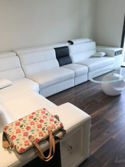 Large white couch in apartment